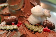 ~ Black Bûche de Noël ~  Each cake is textured to look like a real log and decorated with Meringue mushrooms, holly and berries.