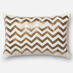 Sequins sparkle and shine in this gorgeous pillow.  Made in India of 100-percent cotton canvas, this down filled or polyester filled pillow or pillow cover features stripes of gold sequins on top of pristine white fabric.