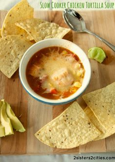 Slow Cooker Chicken Tortilla Soup- this delicious soup takes less than 15 minutes to pull together.  It's a healthy and delicious dinner option.  Serve with tortilla chips, avocados, shredded cheese, and/or sour cream.