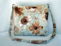 Large hobo bag in brown and beige floral print. by RiverPurseWorks