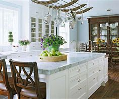 Sky blue walls, off-white cabinets, and rich woods create a cozy and inviting atmosphere Glass Front Cabinets, White Cabinets, Eat In Kitchen, Kitchen Dining, Kitchen Ideas, Kitchen White, Kitchen Decor, Decorating Kitchen, Kitchen Styling