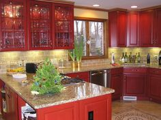 Red Kitchen, Cherry cabinets with cinnabar stain. Tumbled stone backsplash, granite counter tops, porcelain tile and stainless steel appliances., New Red Kitchen - cherry wood cabinets with cinnabar stain., Kitchens Design
