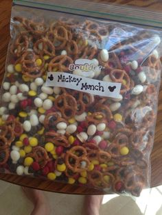 Mickey Munch! - the perfect Disney snack! Pretzels, chocolate chips, yogurt covered raisins or marshmallows, and red and yellow MMs.