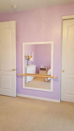 A ballerina bedroom with ballet barre! My daughter wanted to be a ballerina and loved this barre! Click the link and learn how to do this project yourself!