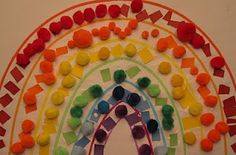 Rainbow St Paddy's Day craft - snipping, matching colours and gluing a rainbow.