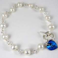 White Pearl Bracelet   Ivory Freshwater Pearls & Bermuda Blue Swarovski Crystal Heart  Beaded Jewelry - ALS Awareness - Wedding Bridal. $15.00, via Etsy.