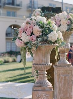 Florals In Urns For An Outdoor Wedding, Ceremony, Or Event