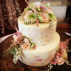 Wedding cake design by our pastry chef Bill at Larkspur Events and Dining in Vail, Colorado and flowers by Perfect Petals.  #weddingcake #larkspurvail  #theperfectpetal #coloradodestinationweddings #vailweddings
