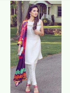 White salwar kameez and  colorful dupattas are never off trend