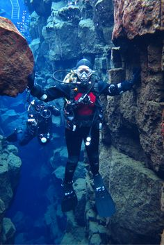 One hand on North America, one on Europe. SCUBA diving between tectonic plates in Silfra, Iceland
