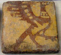 Oiseau, Carreau de pavement , terre glacuree, epoque médiéval  13th-15th century, provenant de Senlis, Laon, ou les environs. Musee de Laon.