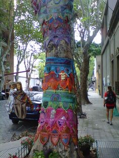 A tree decorated with Indian torans (don't know what the correct plural of toran is).