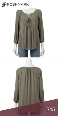 Peasant top Product Details Wear this peasant top with your favorite jeans for a fashionable, easy look.  PRODUCT FEATURES Tasseled tie scoopneck 3/4-length sleeves Elastic cuffs FABRIC & CARE Machine wash 3.21 Tops