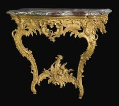 "A PAIR OF LOUIS XV GILTWOOD CONSOLE TABLES MID-18TH CENTURY, SOUTH-GERMAN Each with a haped Campan marble top with a moulded edge, the pierced frieze carved with foliage, rockwork, wings and flowerheads, on shaped legs joined by a stretcher centred by a chimera, the frieze with a paper label printed ""Schloss Inventar Karlsruhe"" inscribed ""3995 3/4"", regilt, the marble tops later $117,310.00"