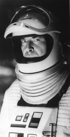 John Koenig in spacesuit.