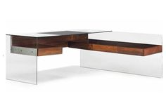 """ANTOINE PHILIPPON/JACQUELINE LECOQ1  /  5 Glass desk, 1967 Rosewood, glass and aluminum 190 x 188 x 75 cm 74.8 x 74 x 29.5 inches Edition E.I.B Minvielle under the label """"Mobilier National"""" Inscribed """"Parsol Sécurit, Saint-Gobain""""  Provenance: Private office of Jacques Duchamel (1924-1977) at the Paris headquarters of the Party for Democracy and Progress (CDP)."""