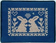 Spring Memories Bunny Love is the title of this cross stitch pattern from Handblessings that also includes a small brass-toned charm as show...