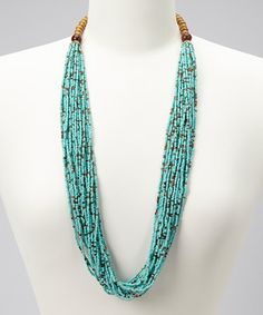 With its natural, handcrafted look, this necklace will give an ensemble the bright boost it deserves. Turquoise-colored seed beads line slender strands to create one statement-worthy accessory.