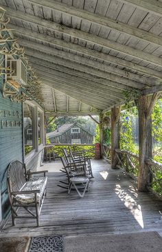 This porch reminds me of summer, friends, good times, long days & long nights....love the antlers on wall