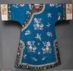 China, woman's silk tunic, Blue silk damask w/ embroidered colorful vignettes of flowered vases & bats, white damask cuffs & sleeve bands w/ seed stitch embroidery & gold couch work, c Gold Couch, Dynasty Clothing, Korean Design, Chinese Embroidery, Silk Tunic, White Damask, Seed Stitch, Clothing And Textile, Embroidered Clothes