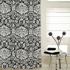 """The black and white bath:  Shower curtain with damask motif.  Product: Shower curtainConstruction Material: PolyesterColor: Black and whiteDimensions: 72"""" H x 70"""" W Cleaning and Care: Machine wash cold and tumble dry low. Do not bleach."""