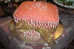 - red velvet cake, peppermint cream cheese frosting. add peppermint sticks and a big gold bow...... viola! easy. i made this for our annual open house, along with three other cakes and oodles of other desserts