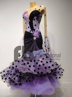 Striking spotted and solid coloured gown in purple hues by fb international