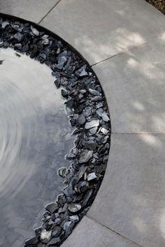 circular stones water mirror