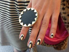 Stripes don't have to be straight--and a hint of metallic makes them even cooler. #nails #nailart #mani