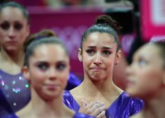 Aly Raisman of the United States reacted after qualifying for the finals of the all-around gymnastics competition.