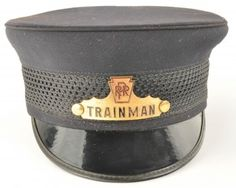 Railroad Trainman's Cap from the Pennsylvania railroad with enameled hat badge and woven band, no manufacturer's mark. size: unmarked