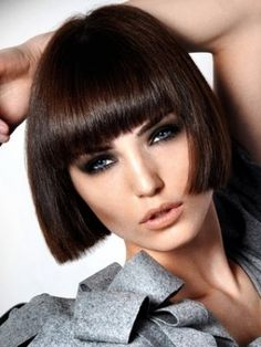 Pretty blunt cut fringe and blunt cut at bottom. Great highly smokey eye makeup too. But maybe in a very light blond...