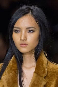 Makeup Artistic Consultant for Burberry,Wendy Rowe used the luxe label's beauty collection to create smoky eyes inspired by natural earthy tones. The matte nude lips and warm skin complemented the look beautifully.   - Cosmopolitan.co.uk