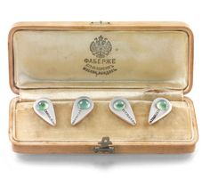 A PAIR OF RARE FABERGÉ JEWELLED GOLD AND PLATINUM CUFFLINKS, WORKMASTER AUGUST HOLLMING, ST PETERSBURG,  1911    each link of teardrop form, set with a cabochon chrysoprase issuing a band of rose-cut diamonds, the surfacelayered withmatte finish platinum-silver alloy, struck with workmaster's initials, 56 standard, scratched inventory number 87617, in original Fabergé wood box