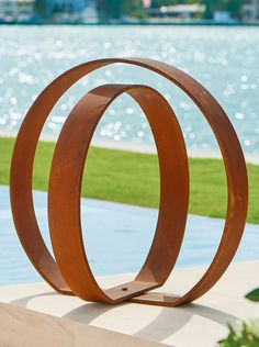 Put an inspired finishing touch on your garden space with a work of adaptable art, using our sleek Orb Garden Sculpture. The two concentric spheres are hinged at the bottom, so you can pivot the inner circle for the exact look you want-and change the profile whenever the spirit strikes. Rustic weathered finish will continue to gain distinctive character with each passing season. Large Backyard Landscaping, Backyard Ideas, Garden Ideas, Outdoor Ideas, Outdoor Stuff, Outdoor Art, Landscaping Ideas, Backyard Retreat, Outdoor Decor