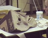 Mask using a box corner! Paper mache or sculpt a mold over tag board armature or crumpled paper towels taped in place
