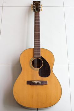 Not my specific first guitar, but same model (Yamaha FG 75). Got it in Trade for 12 lawn cuts. You could measure the action with a yard stick...