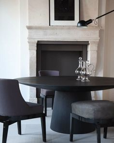 This modern, matte black dining room set perfectly embodies simple glamour