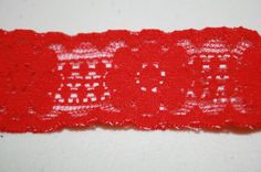 This listing is for 10 yards of red, elastic lace. It is one inch wide. Perfect for lingerie, headbands, thongs, garters, etc.