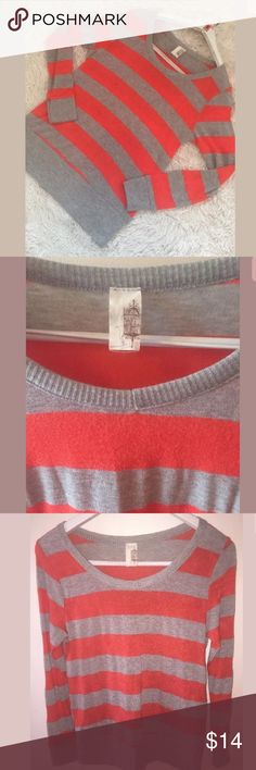 """Francesca's Collections Striped Sweater Francesca's Orange Gray Striped Sweater Shirt Top. Crew neck. Long Sleeve. Pullover.  49% Polyester 46% Rayon 5% Spandex Pre-owned in great condition. Women's Size M. Measures 18"""" across chest arm pit to arm pit laying flat. Length is 24"""" long measured from top of shoulder to bottom. Shoulder to shoulder measures 14"""" across laying flat. Sleeves are 30"""" long measured from back of neck to bottom of sleeve. Francesca's Collections Sweaters Crew & Scoop…"""