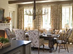 Chairs and benches of differing styles gather around the English refectory table in this Southern Accents Showhouse in Fort Worth, Texas, giving a casual, collected feel that invites intimacy and relaxation