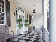 never really thought of using a black and white checked floor on a porch, but it could work!