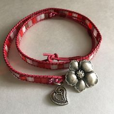 2X wrap leather bracelet-- Tila beads, rosy pink leather, hibiscus button, I loved making this wrap and how it turned out...
