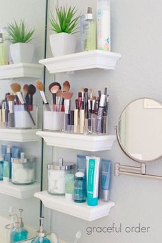 Combat bathroom clutter with a few small shelves to provide great storage