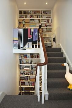 • bookshelves along the stairs (via In London, Revisiting a Childhood Home   Design*Sponge)