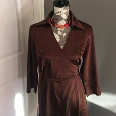 Brown silk like dress Brown silk like wrap dress.  Has a little bit of stretch to it.  Lovely.  It's a re-posh, just didn't fit me correctly! Dahiny Dresses