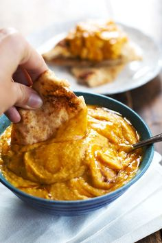 Roasted Garlic and Rosemary Pumpkin Hummus. 100 calories and totally addicting. From Pinch of Yum.