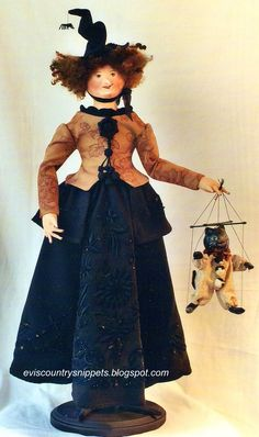 Beautiful witch carrying a cat marionette. I created them using paper-clay over fabric for the heads, and dressing them in antique fabrics.