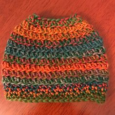 Free crochet messy bun hat pattern that can be worked up in an hour or less!