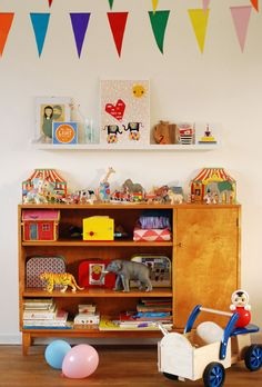This looks like a brightly coloured kids' room - but look closely and the colour is only from the accessories and toys...perfect when you're nervous of painting the walls brightly.  Via designedforkids.co.uk